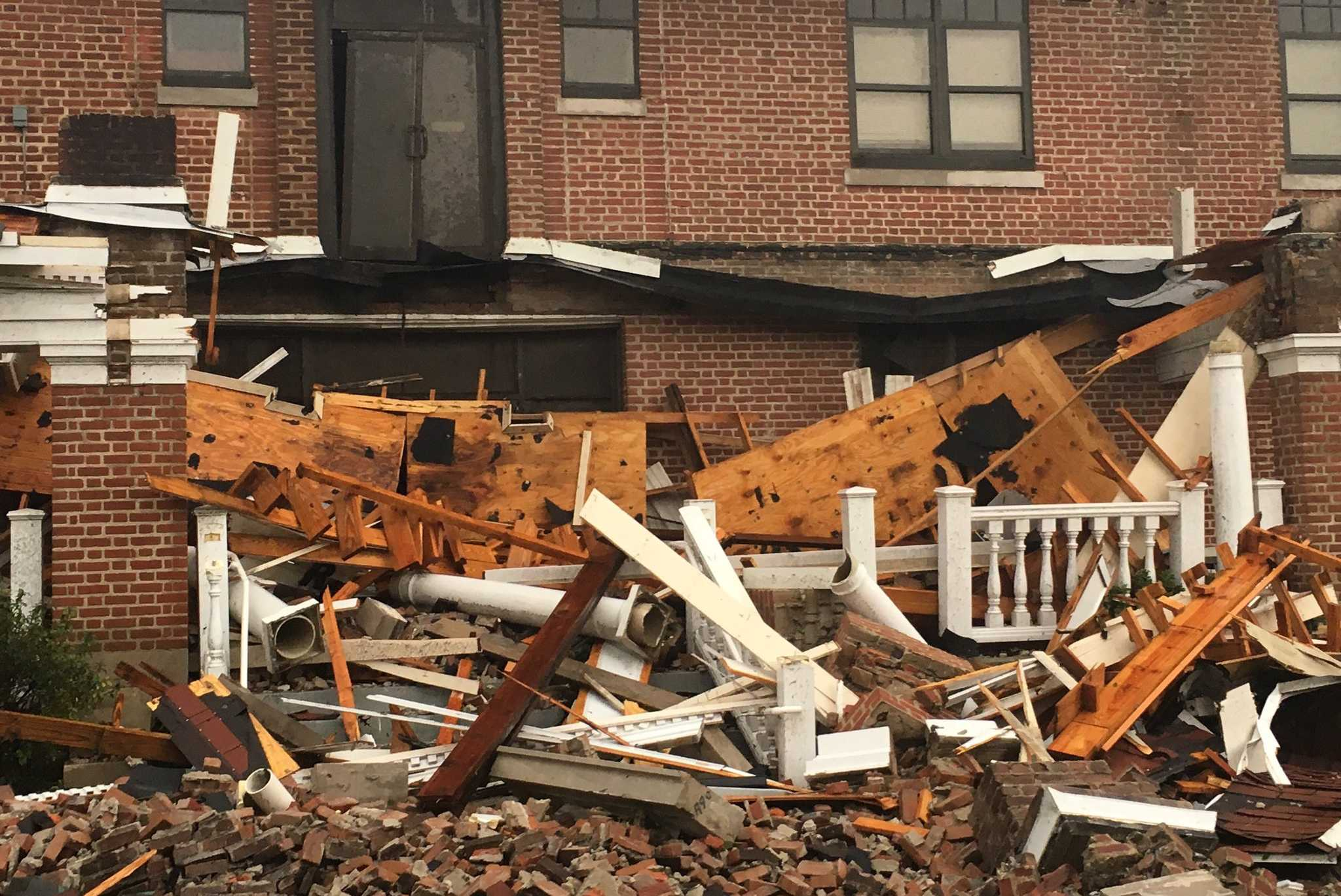 Buildings are damaged on the campus on William Carey University after a tornado ripped through Hattiesburg, Miss., Jan. 21, 2017.