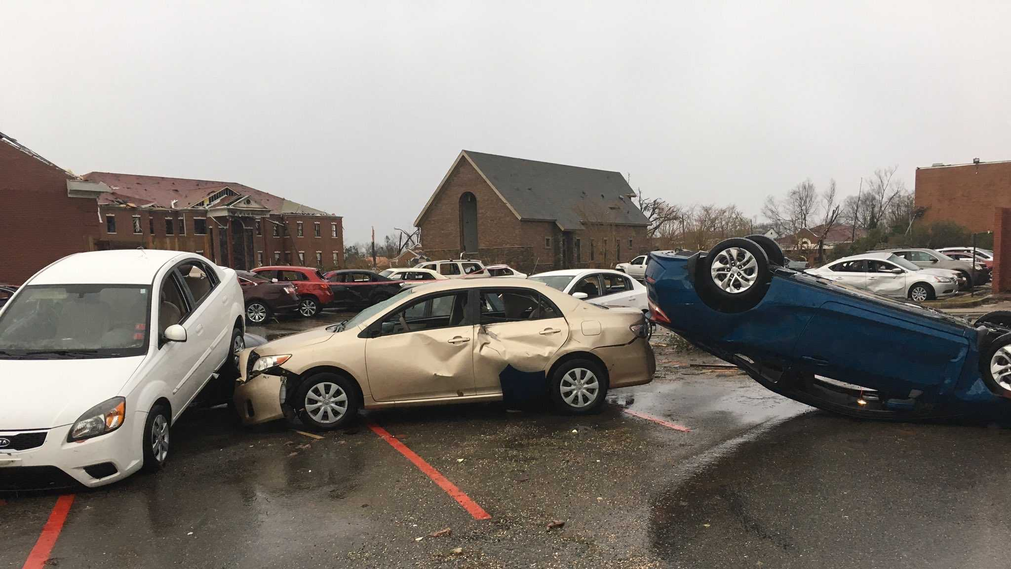 Cars are damaged at William Carey University after a tornado ripped through Hattiesburg, Miss., on Jan. 21, 2017.