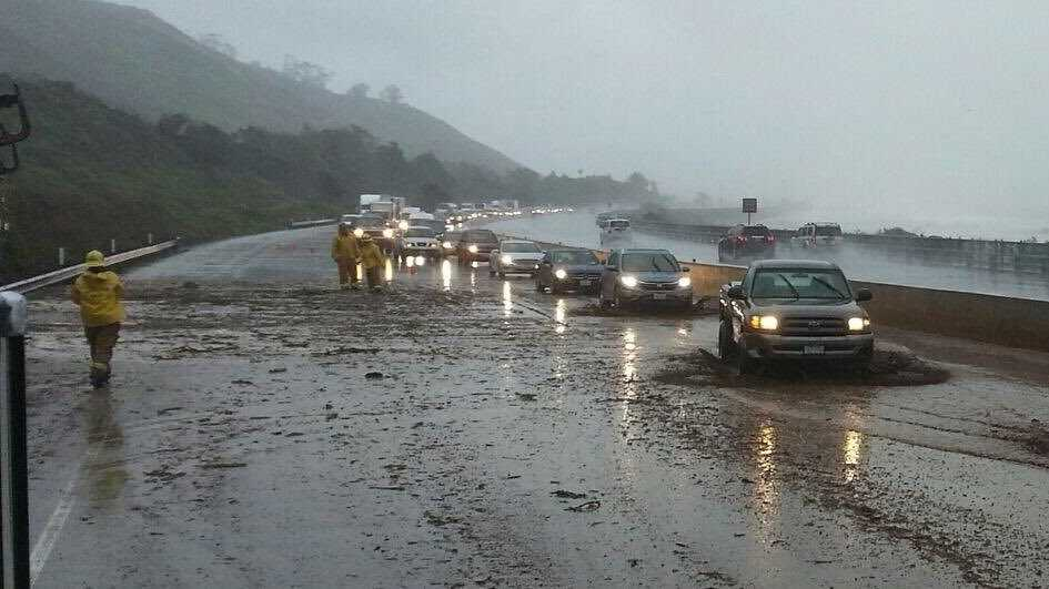 Torrential downpours were hitting Southern California on Friday, while northern parts of the state brace for the impact of more rain on Oroville Dam's damaged spillway early next week. Lanes are closed due to heavy rain and mud at Seacliff exit on the Pacific Coast Highway.