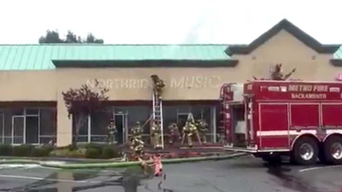 Firefighters battle blaze at a music store in a Citrus Heights strip mall on Sunday, Dec. 11, 2016.