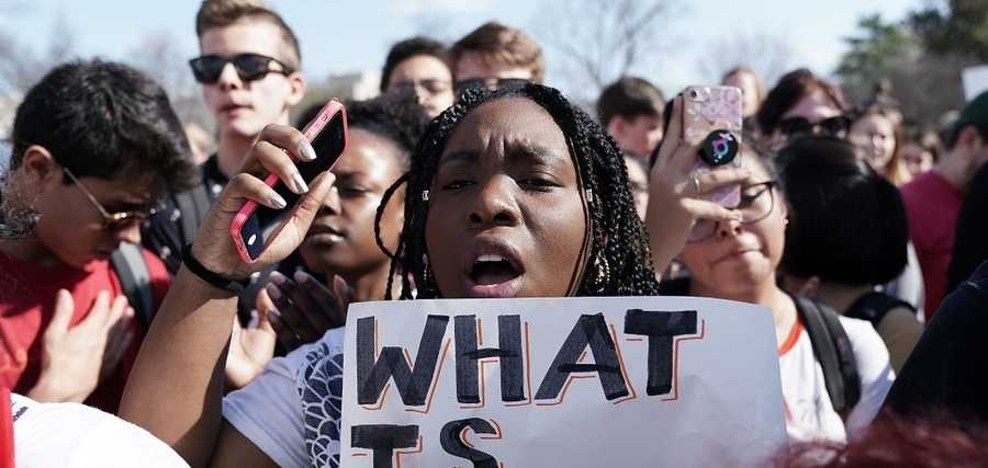 Students participate in a protest against gun violence Feb. 21, 2018 on Capitol Hill in Washington. Hundreds of students walked out of their classrooms and made a trip to the U.S. Capitol and the White House.