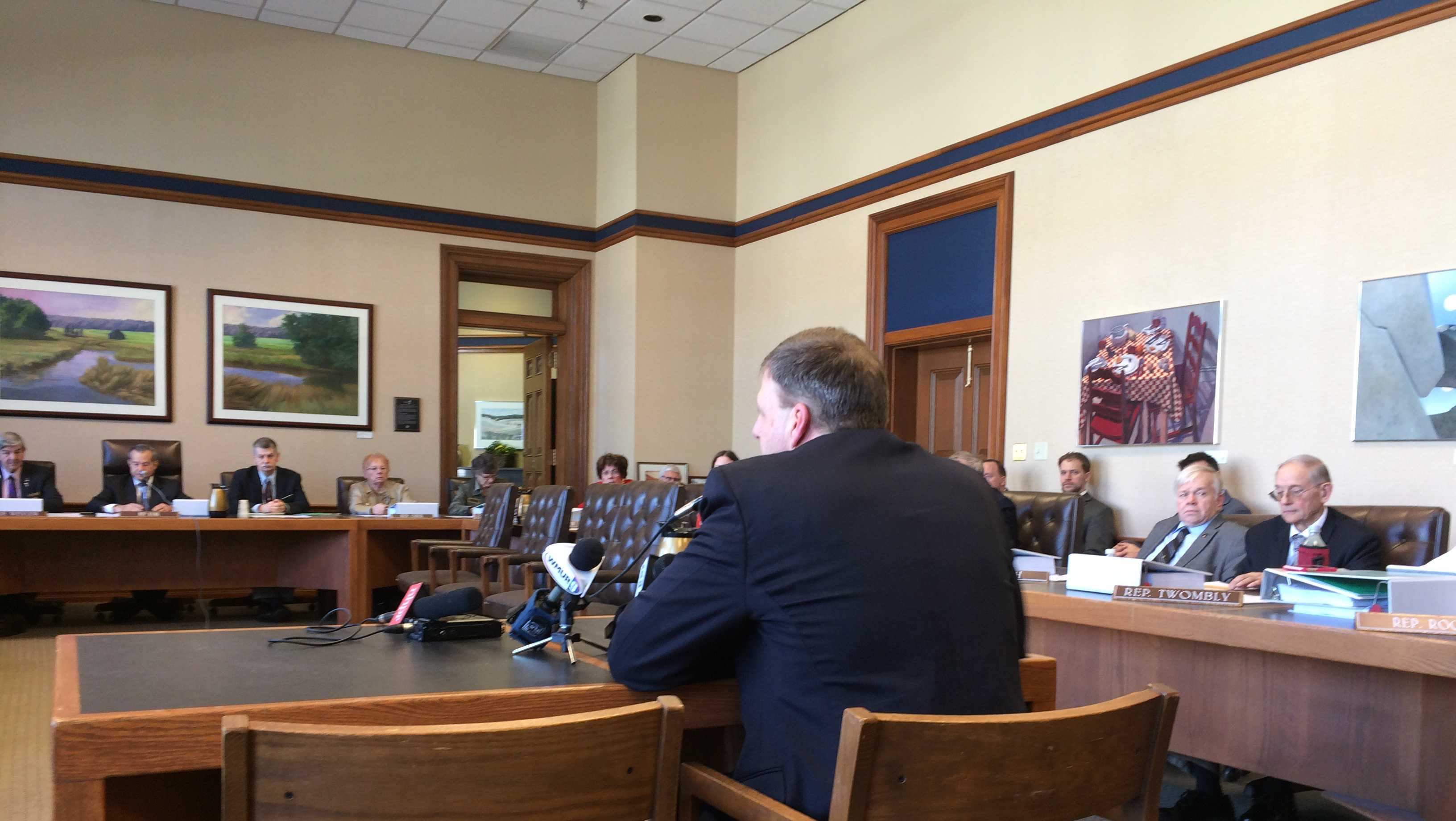 Gov. Chris Sununu presents his budget to members of the House and Senate finance committees Tuesday.