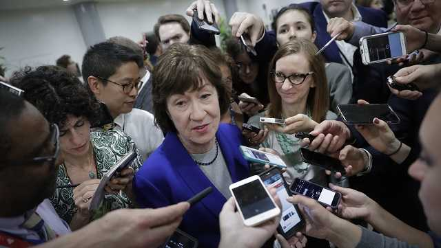 Sen. Susan Collins, R-Maine, speaks amid a crush of reporters after Republicans released their long-awaited bill to scuttle much of President Barack Obama's Affordable Care Act, at the Capitol in Washington, Thursday, June 22, 2017.