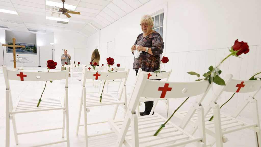 Sutherland Springs resident Helen Biesenbach visits the First Baptist Church of Sutherland Springs Memorial Sunday Nov. 12, 2017.