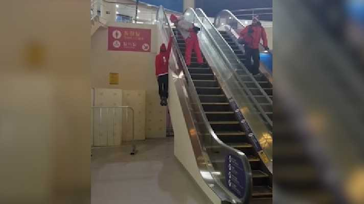 Swiss freestyle skier Fabian Bösch has an interesting way of using an escalator