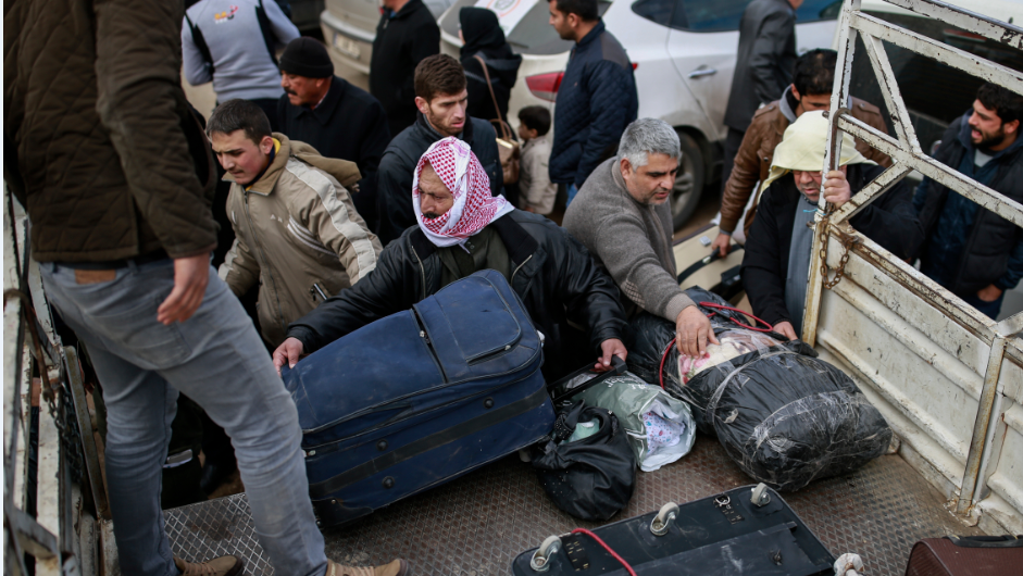 Syrians evacuated from the embattled Syrian city of Aleppo during the ceasefire arrive at a refugee camp in Rashidin, near Idlib, Syria, early Monday, Dec. 19, 2016.