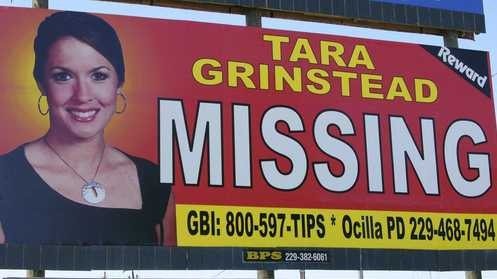 The Wednesday, Oct. 4, 2006, file photo of missing teacher Tara Grinstead is prominently displayed on a billboard in Ocilla, Ga. Grinstead's disappearance on Oct. 22, 2005, was marked by a ceremony in Ocilla. Authorities in rural south Georgia say they plan to update the public, Thursday, Feb. 23, 2017, on their 11-year search for a missing teacher. A former beauty queen who taught at Irwin County High School, Grinstead was 30 years old when she vanished in October 2005 from her home.
