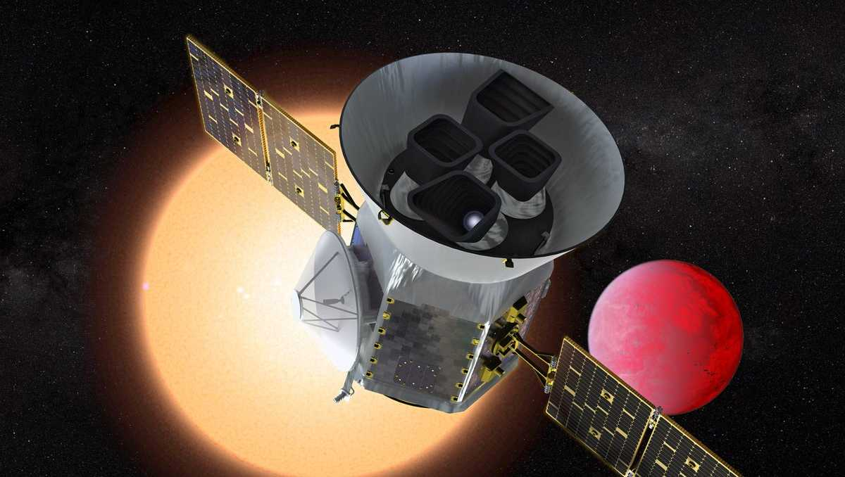 Illustration of the Transiting Exoplanet Survey Telescope (TESS) in front of a lava planet orbiting its host star. TESS will identify thousands of potential new planets for further study and observation.