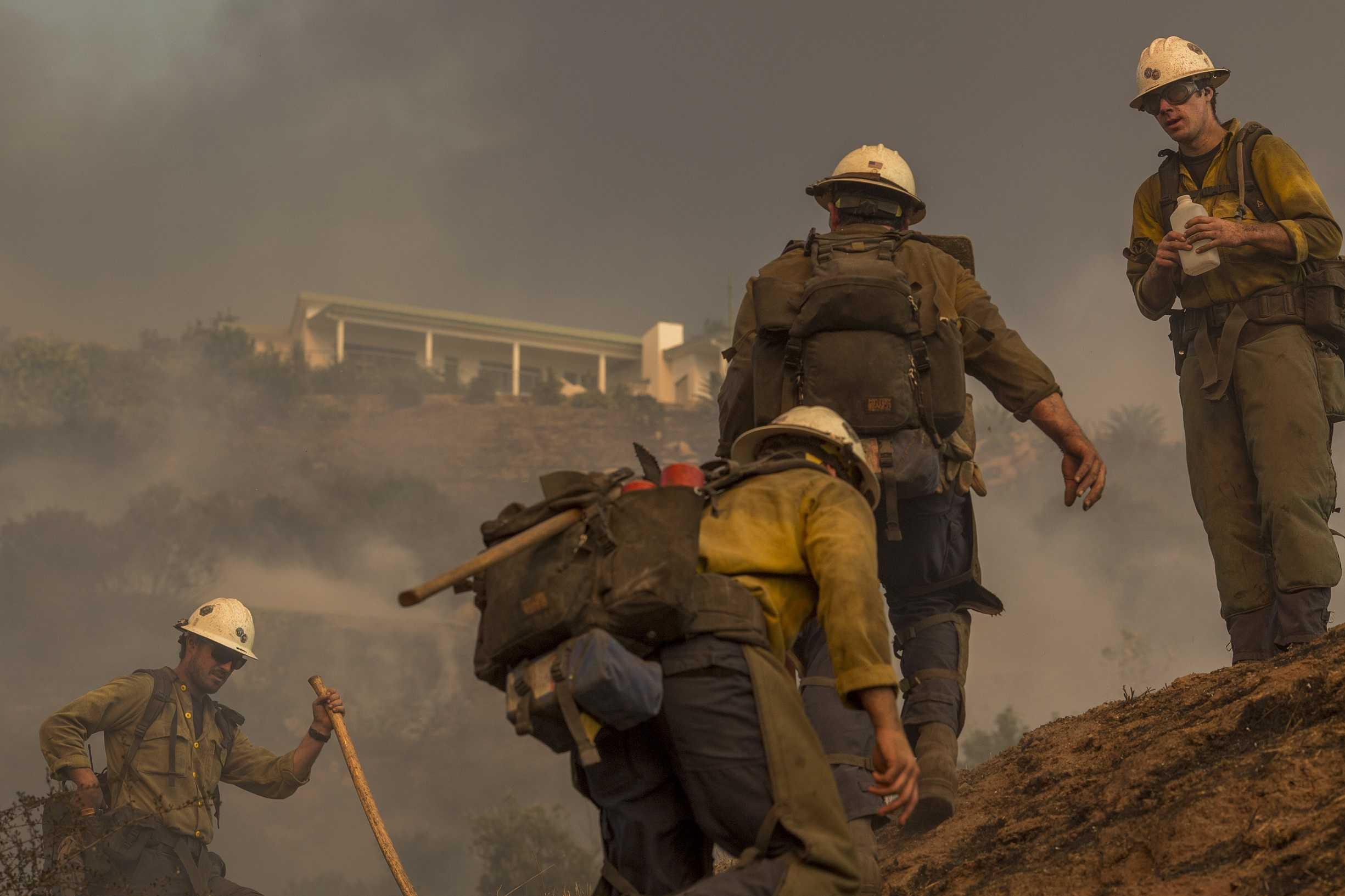 8,000 firefighters take on Southern California wildfires