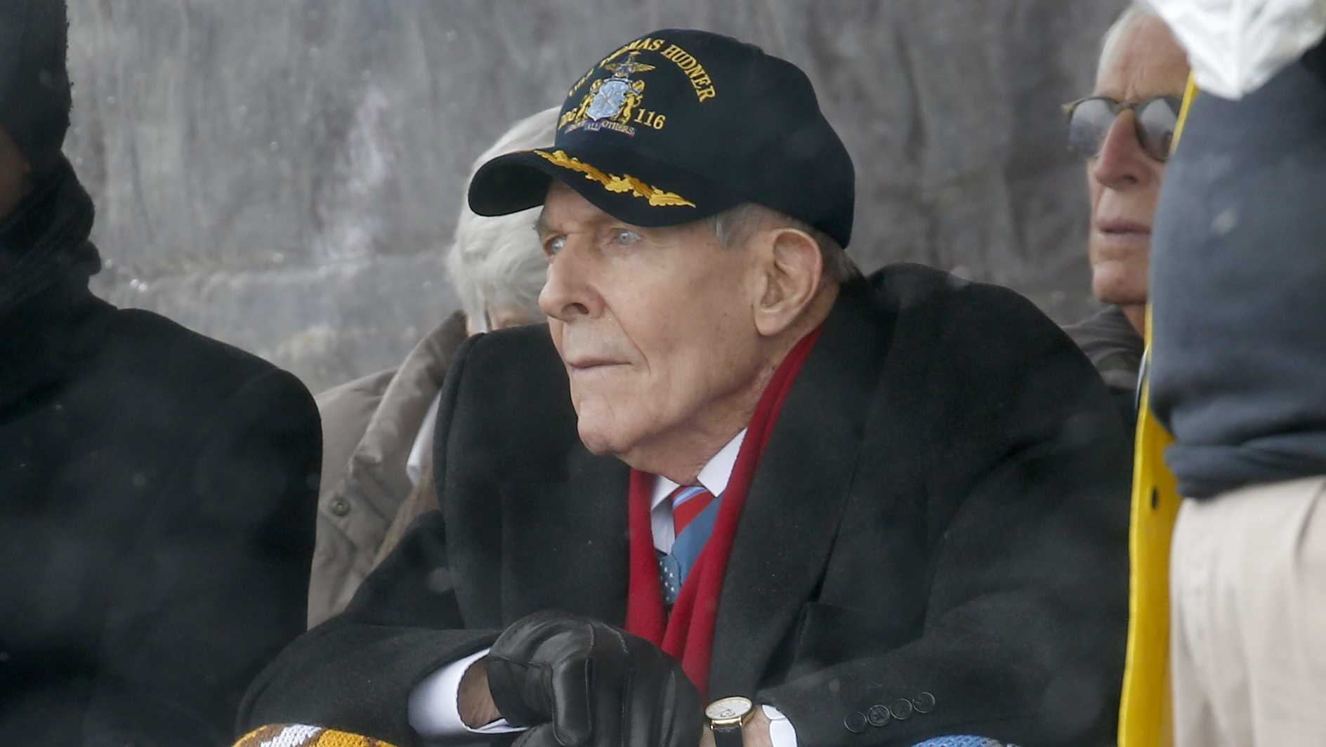Korean War veteran Thomas Hudner looks on during the christening ceremony for the future USS Thomas Hudner, a U.S. Navy destroyer named in his honor, at Bath Iron Works .