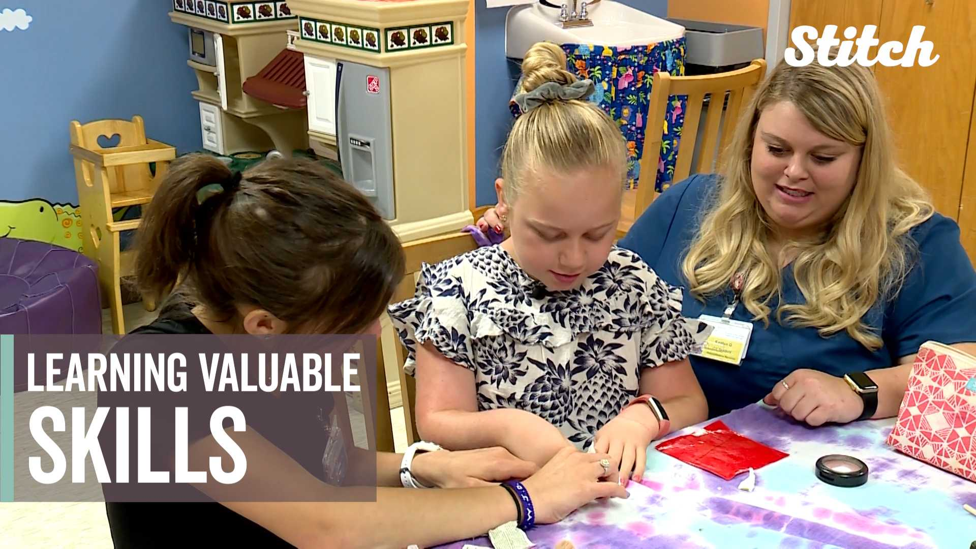 Girls learn how to put on makeup, paint nails at camp for special needs children