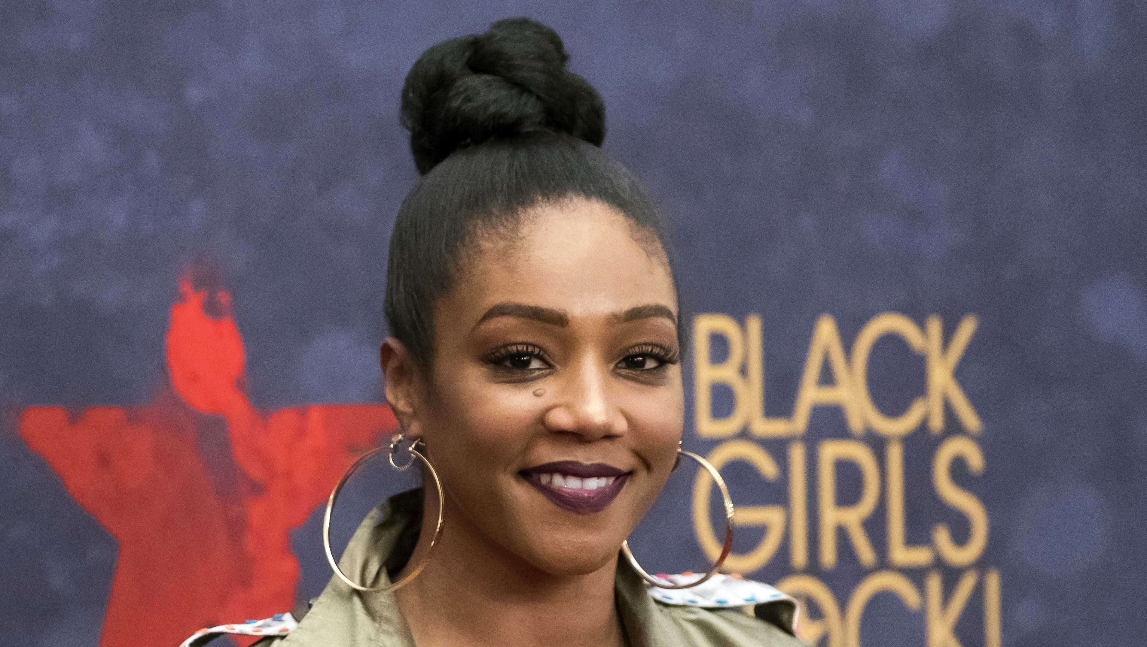 """In this Aug. 5, 2017 file photo, Tiffany Haddish attends the Black Girls Rock! Awards at the New Jersey Performing Arts Center in Newark, N.J. Haddish is set to host the 2018 MTV Movie & TV Awards. The network announced Thursday, Feb. 22, 2018, that the """"Girls Trip"""" breakout star will host the ceremony in Los Angeles on June 18."""