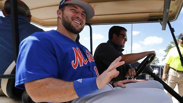 New York Mets outfielder and former NFL quarterback Tim Tebow leaves a news conference at the baseball teams spring training facility in Port St. Lucie, Fla., Monday, Feb. 27, 2017.