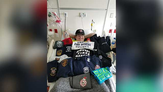 Timothy Richardson, a 16-year-old who hopes to be a firefighter, is surrounded by t-shirts from fire departments while he's in the hospital for Leukemia treatments.