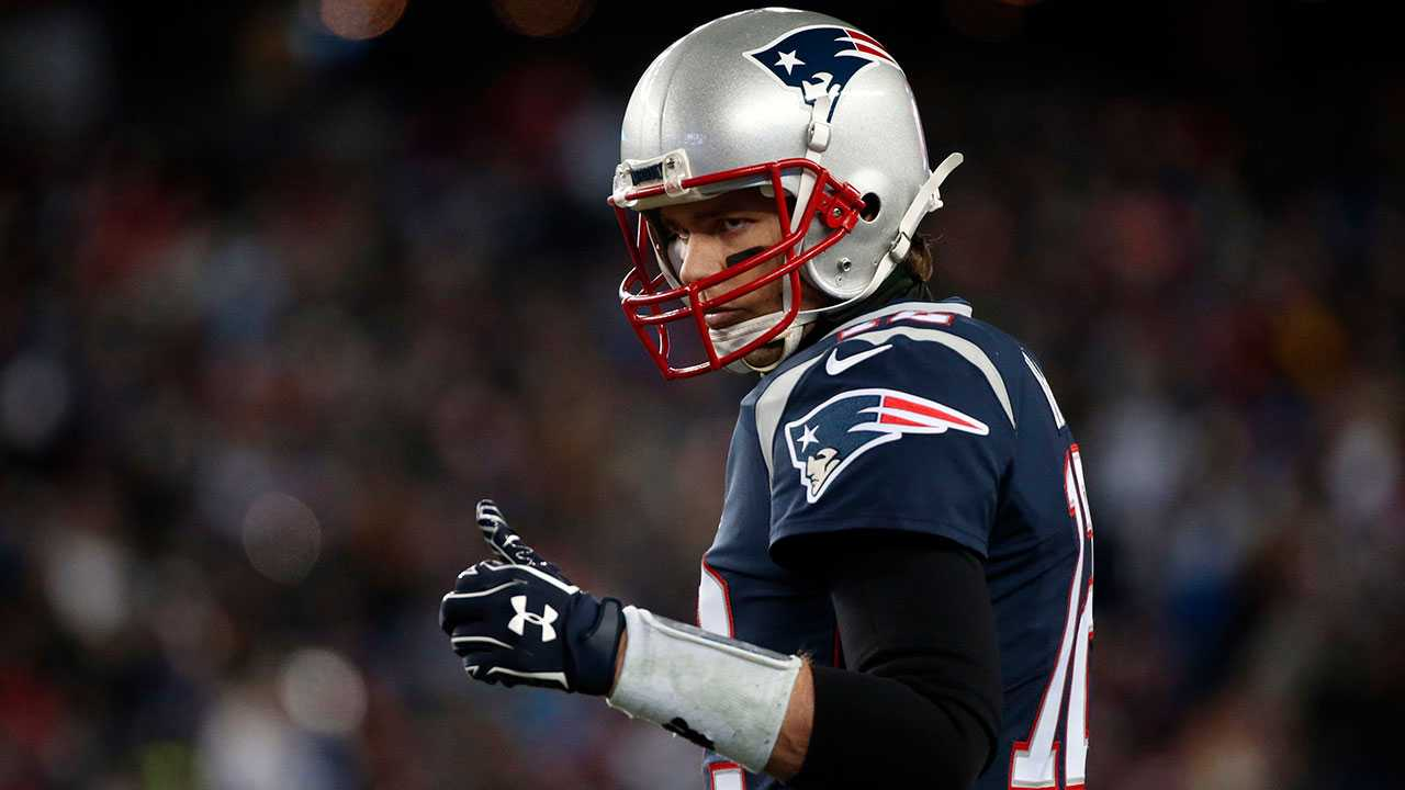 New England Patriots quarterback Tom Brady signals to the sideline during the first half of an NFL divisional playoff football game against the Tennessee Titans Saturday Jan. 13 2018 in Foxborough Mass