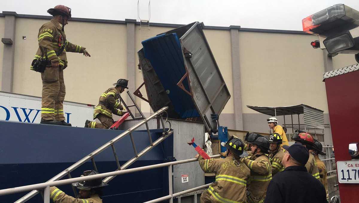 Sacramento trash compactor rescue