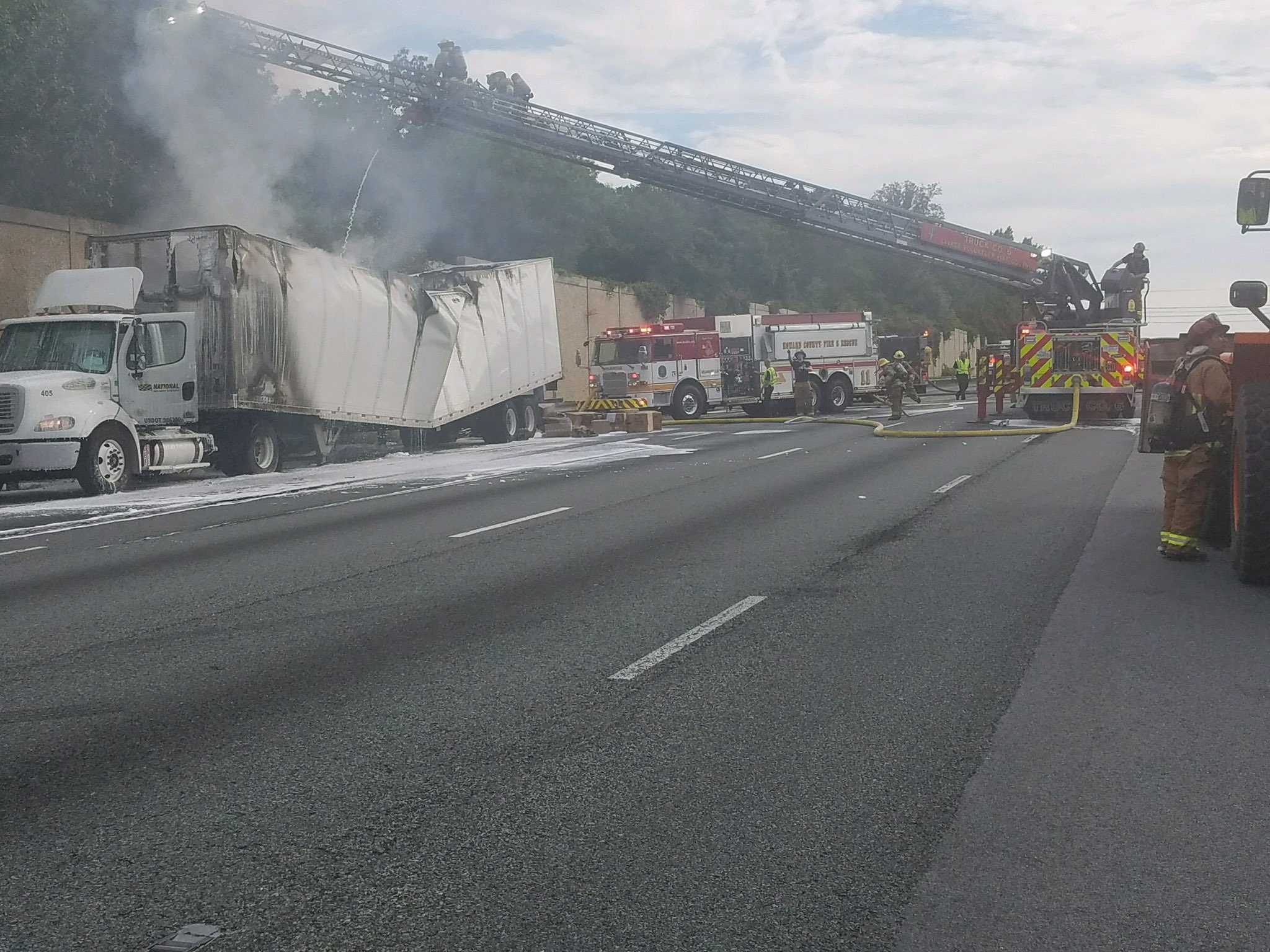 2 tractor trailers crash down embankment on I-95 in West Haven