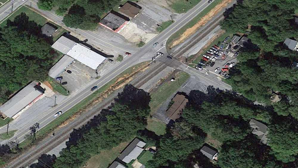 Train, vehicle collide