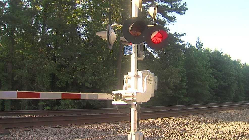 Authorities say two people were killed after a car collided with a train in northeast Arkansas.