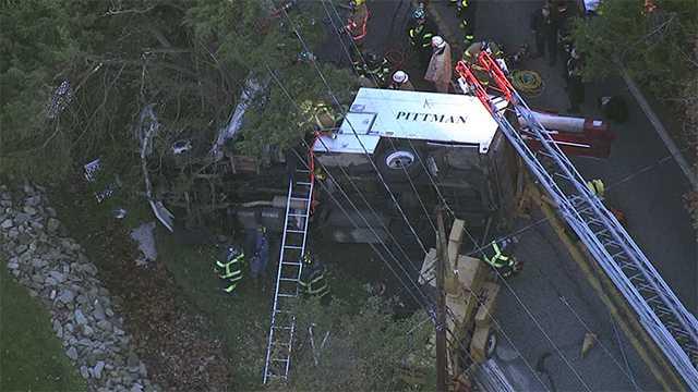 utility truck overturned in Butler