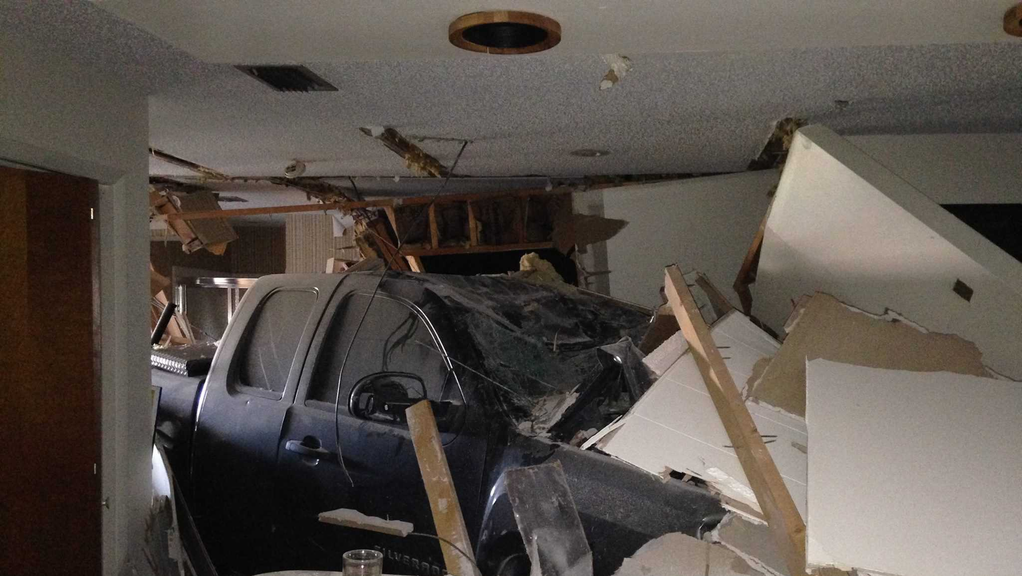 Truck crashes into home