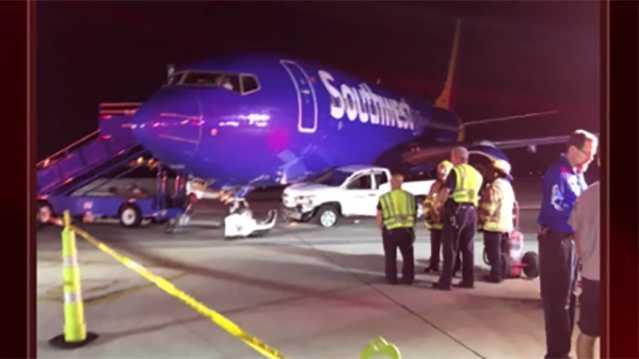 Truck hits Southwest plane