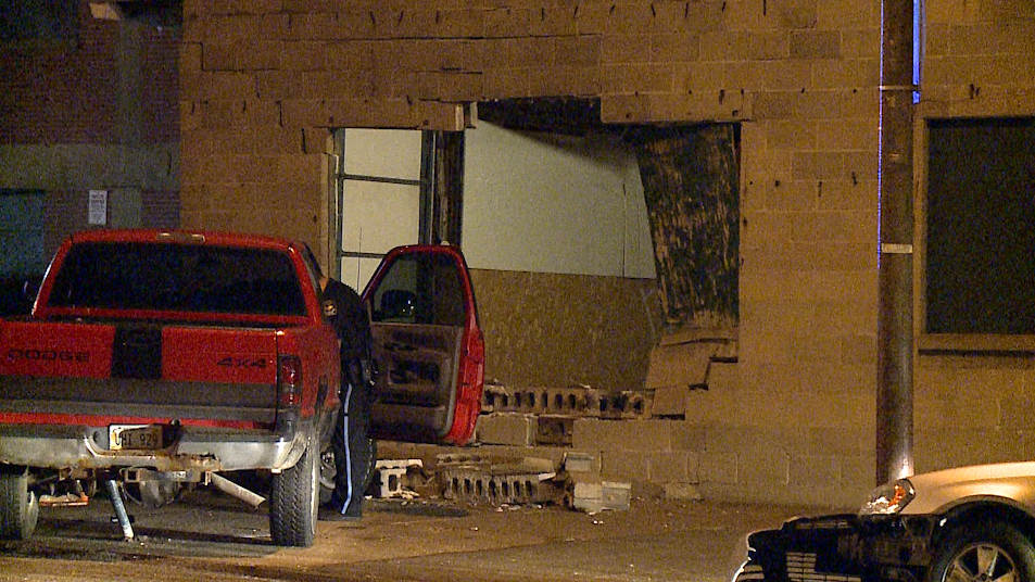 Pickup hits building, 13th & Jones