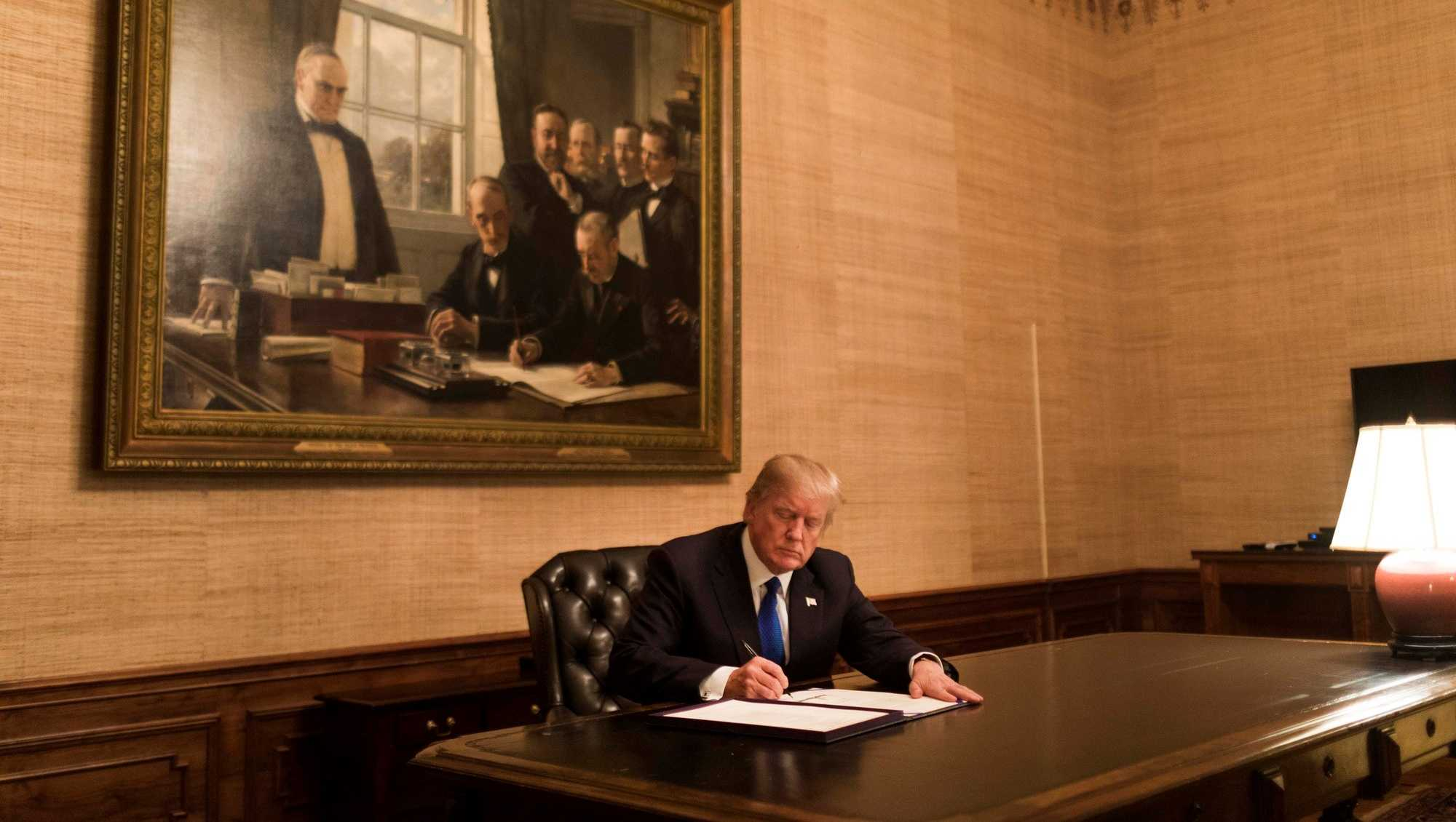 President Donald Trump signs H.R. 195 , in the Treaty Room at the White House, Monday January 22, 2018, in Washington, D.C.