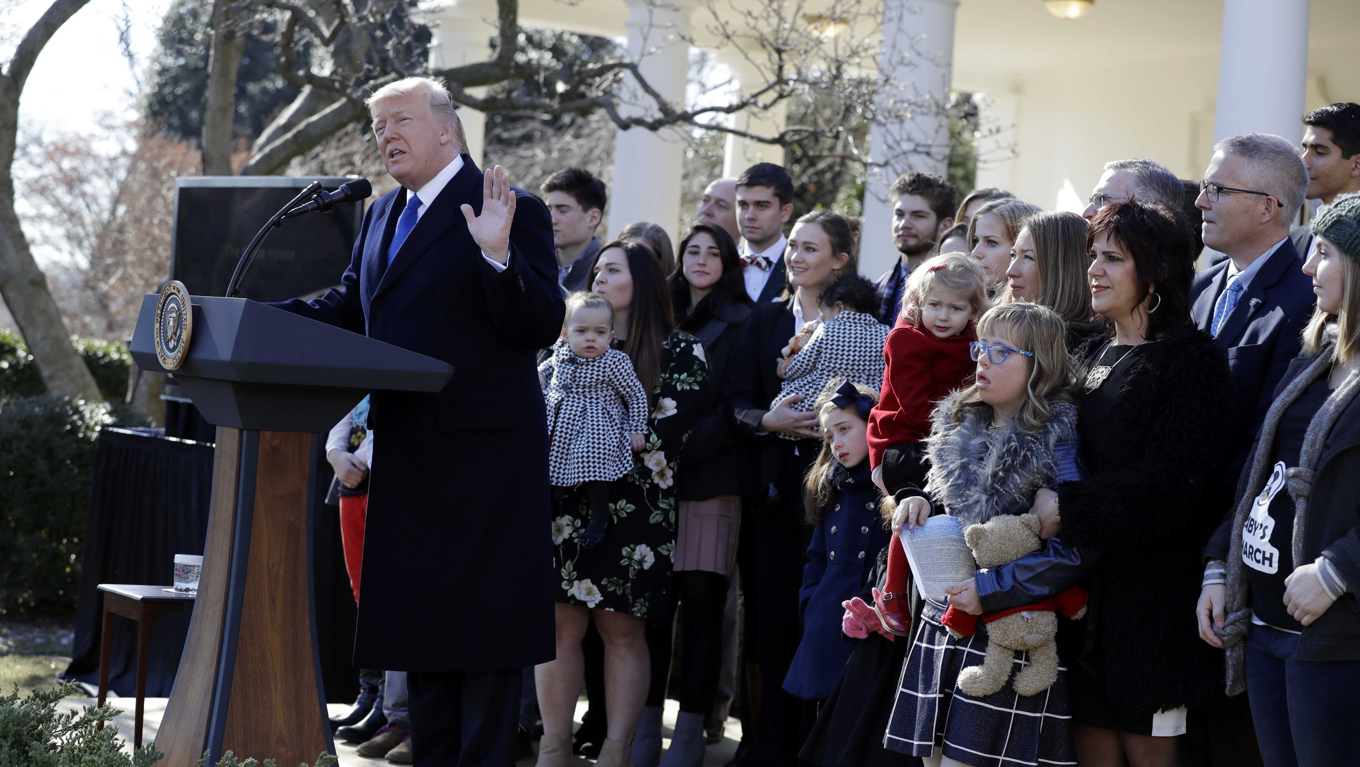 President Donald Trump speaks to the March for Life participants from the Rose Garden of the White House, Friday, Jan. 19, 2018, in Washington.