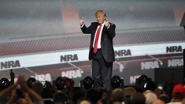 President Donald Trump gestures after speaking at the National Rifle Association-ILA Leadership Forum, Friday, April 28, 2017, in Atlanta.