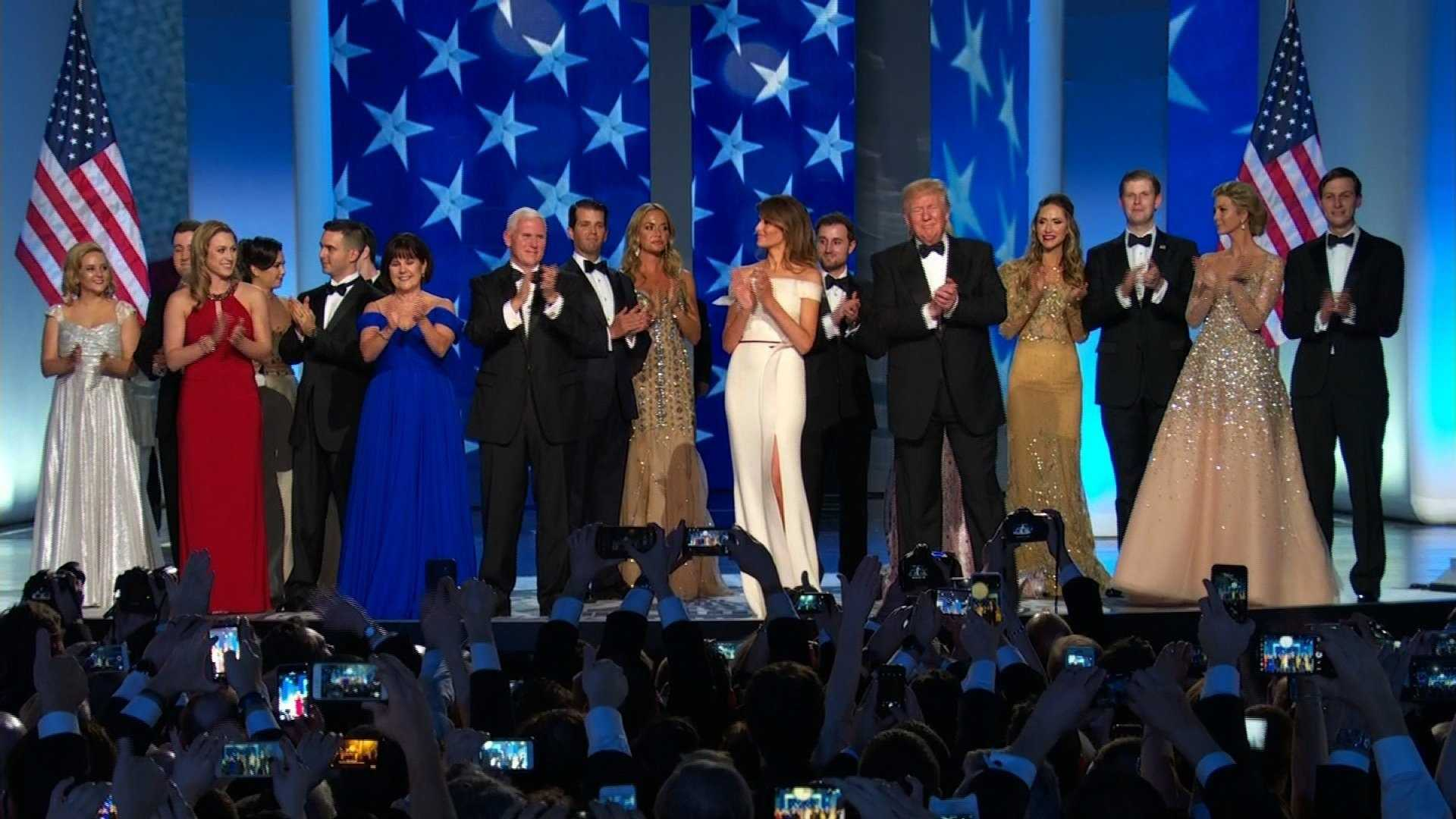 President Donald Trump on stage with his family and Vice President Mike Pence at the inaugural ball on January 20, 2017