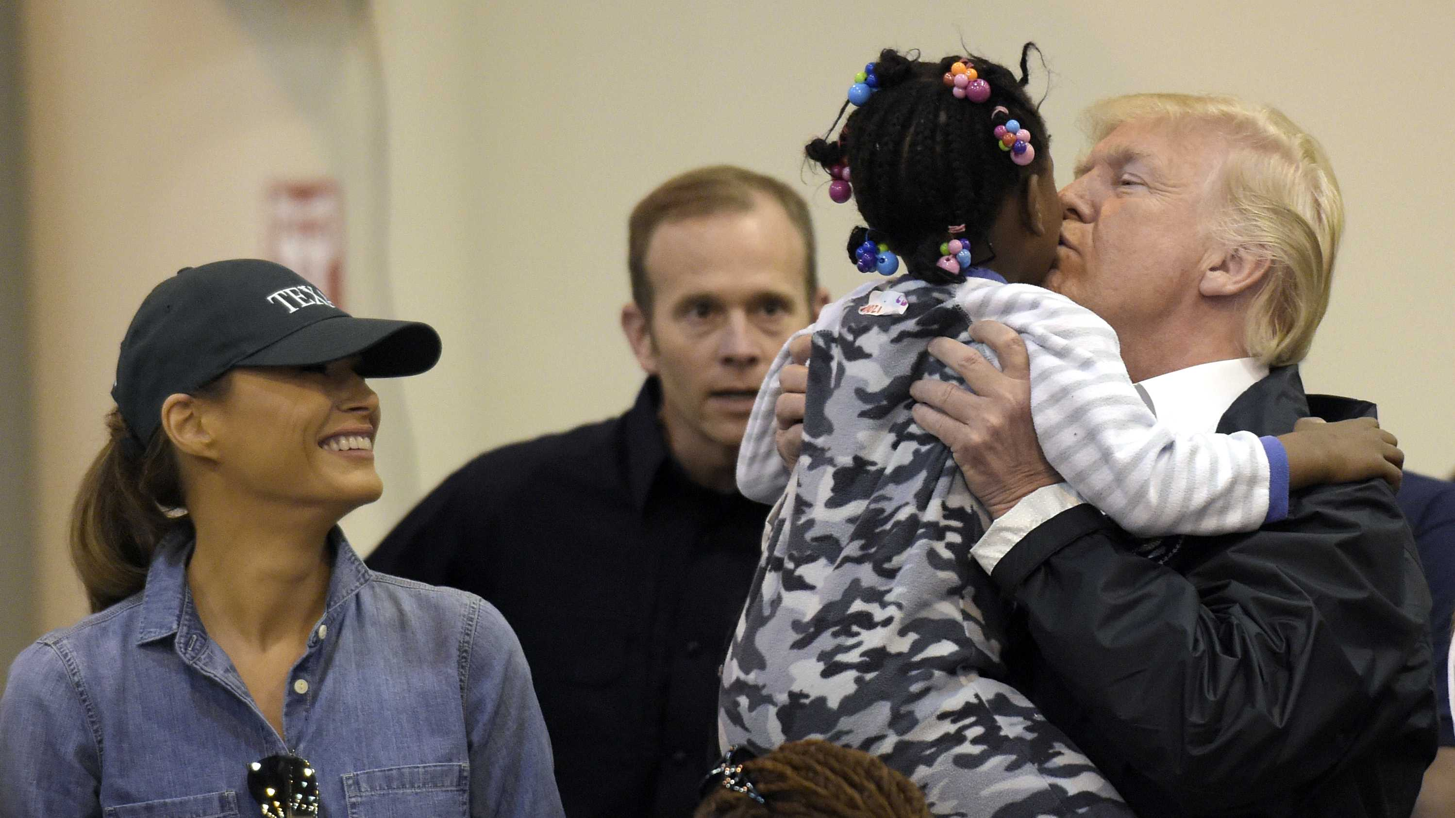 President Donald Trump and Melania Trump meet people impacted by Hurricane Harvey during a visit to the NRG Center in Houston, Saturday, Sept. 2, 2017.