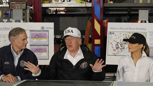 President Donald Trump, flanked by Texas Gov. Greg Abbott and first lady Melania Trump speaks during a briefing on Harvey relief efforts, Tuesday, Aug. 29, 2017, at Firehouse 5 in Corpus Christi, Texas.