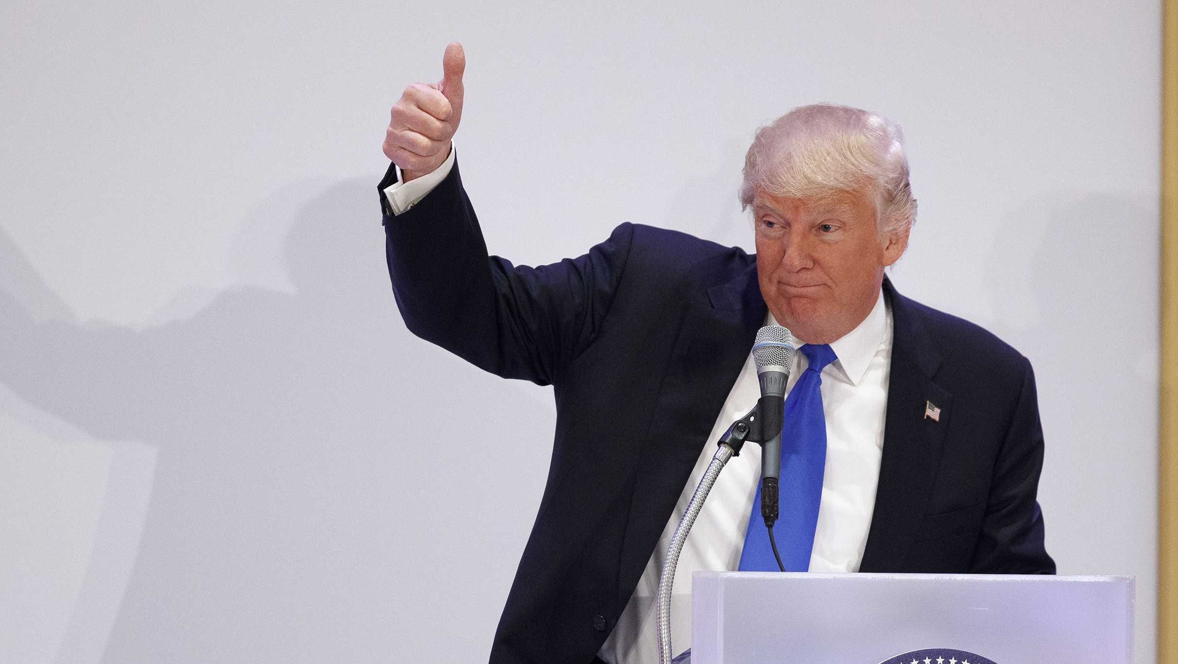 President Donald Trump gives a thumbs-up as he speaks during the Leadership Luncheon at Trump International in Washington.