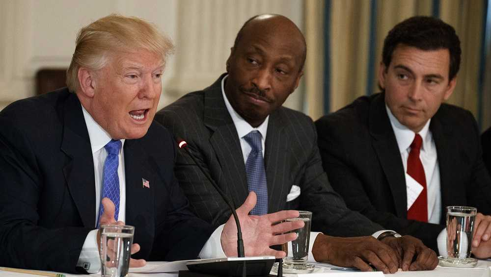 "In this Thursday, Feb. 23, 2017, file photo, President Donald Trump, left, speaks during a meeting with manufacturing executives at the White House in Washington, including Merck CEO Kenneth Frazier, center, and Ford CEO Mark Fields. Frazier is resigning from the President's American Manufacturing Council citing ""a responsibility to take a stand against intolerance and extremism."" Frazier's resignation comes shortly after a violent confrontation between white supremacists and protesters in Charlottesville, Va. Trump is being criticized for not explicitly condemning the white nationalists who marched in Charlottesville."