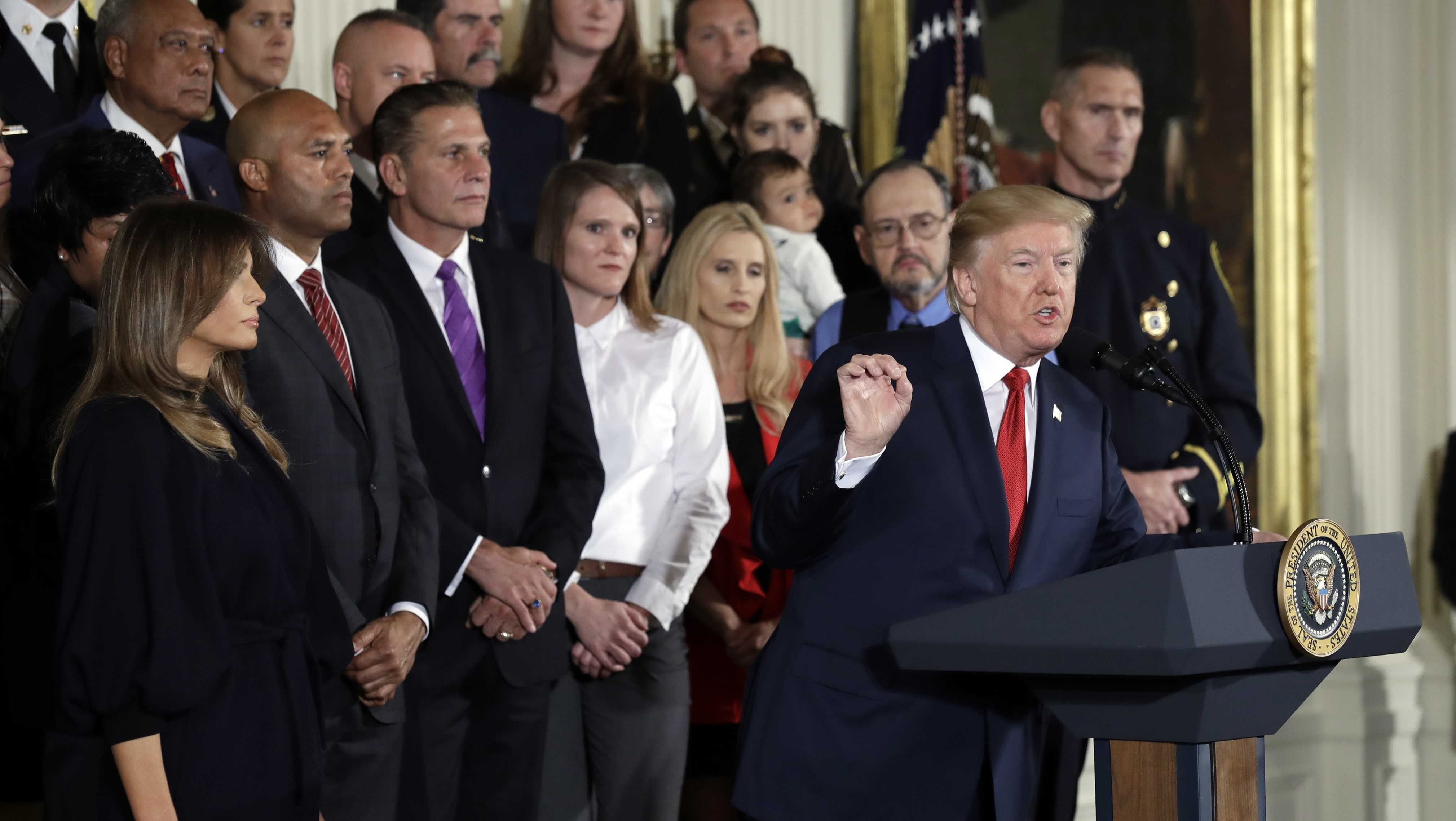 President Donald Trump speaks during an event to declare the opioid crisis a national public health emergency in the East Room of the White House, Thursday, Oct. 26, 2017, in Washington. First Lady Melania Trump listens at left.