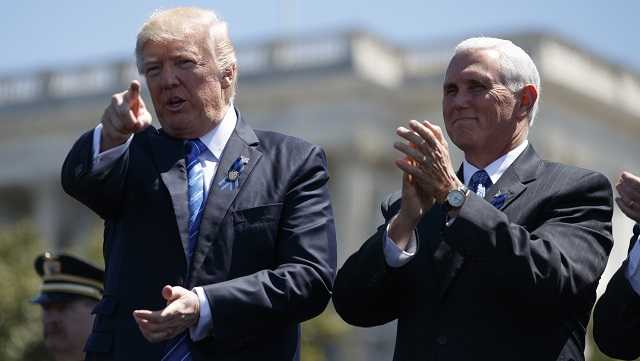 President Donald Trump stands with Vice President Mike Pence