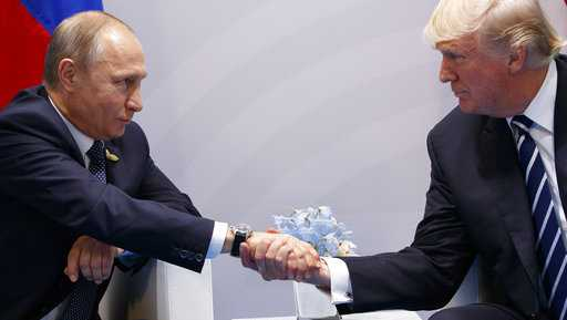 President Donald Trump shakes hands with Russian President Vladimir Putin at the G20 Summit, Friday, July 7, 2017, in Hamburg.