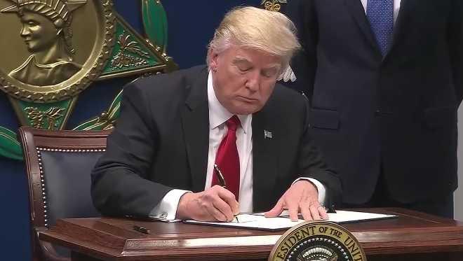 President Donald Trump signing