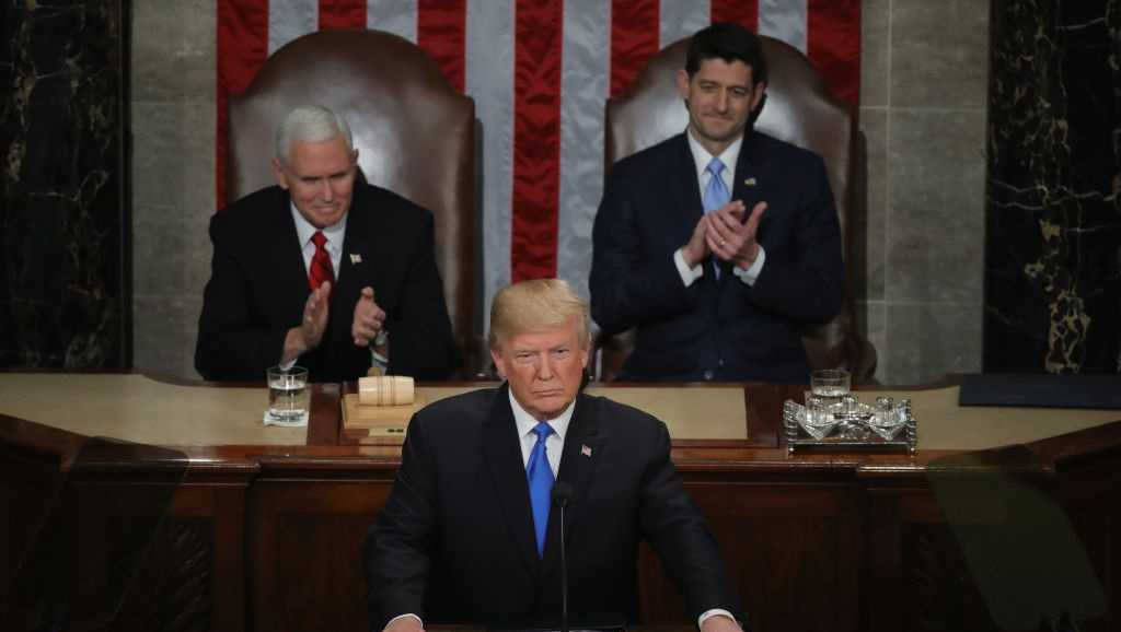 President Donald J. Trump delivers the State of the Union address as U.S. Vice President Mike Pence (L) and Speaker of the House U.S. Rep. Paul Ryan (R-WI) (R) look on in the chamber of the U.S. House of Representatives January 30, 2018 in Washington, DC