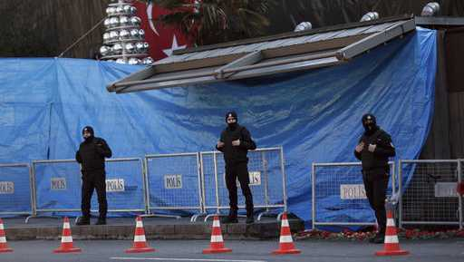 Turkish police officers stand guard outside the scene a day after an attack at a popular nightclub in Istanbul, Monday, Jan. 2, 2017. A manhunt is on in Turkey as authorities work to identify the assailant who killed dozens of people in a crowded Istanbul nightclub during New Year's celebrations Sunday.
