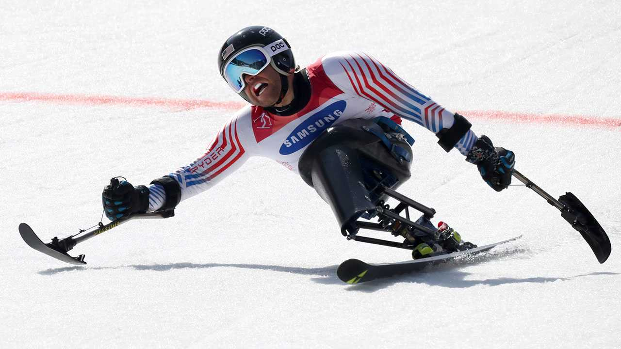 Tyler Walker of United States pushes past the finish line in the Alpine Skiing Men's Giant Slalom Sitting event for the 2018 Winter Paralympics at the Jeongseon Alpine Center in Jeongseon, South Korea, Wednesday, March 14, 2018.