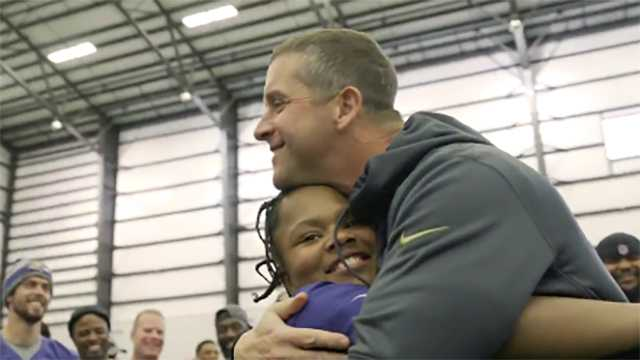 Coach John Harbaugh and Amanda