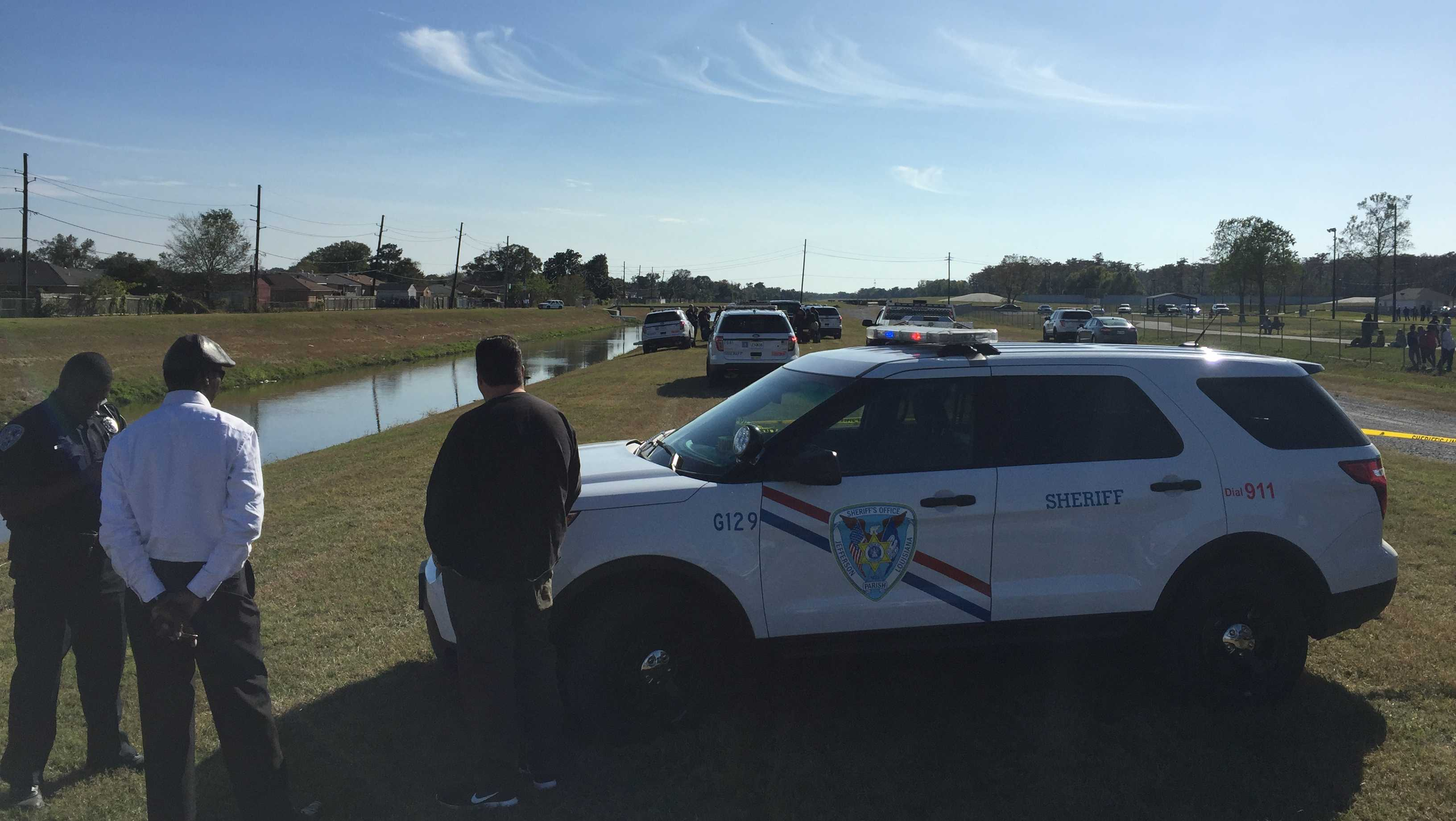 Deputies investigate a man who was found dead in a Marrero canal Sunday.