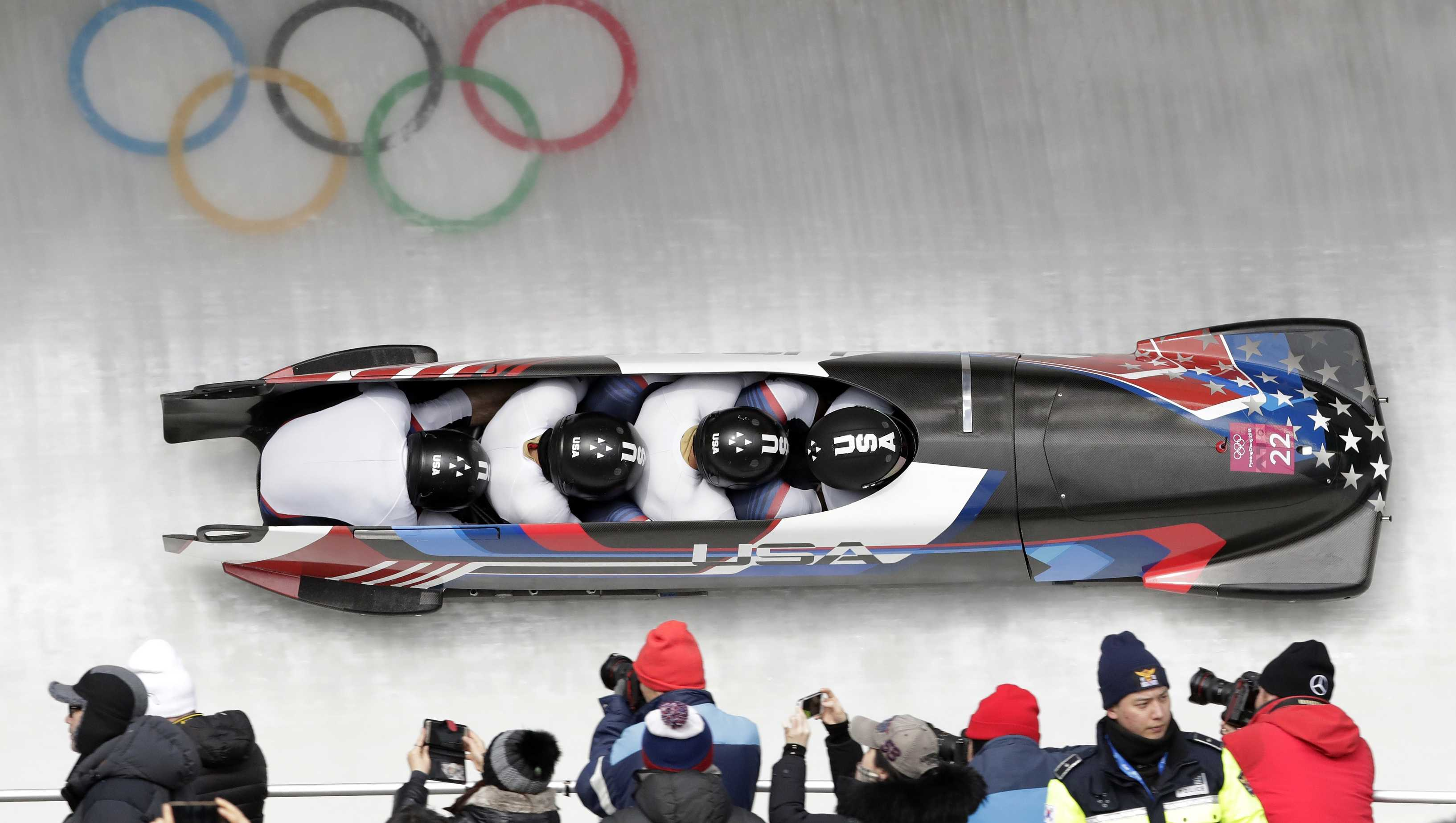 Driver Nick Cunningham, Hakeem Abdul-Saboor, Christopher Kinney, Samuel Michner of the United States take a curve in the second heat of the four-man bobsled competition at the 2018 Winter Olympics in Pyeongchang, South Korea, Saturday, Feb. 24, 2018. )