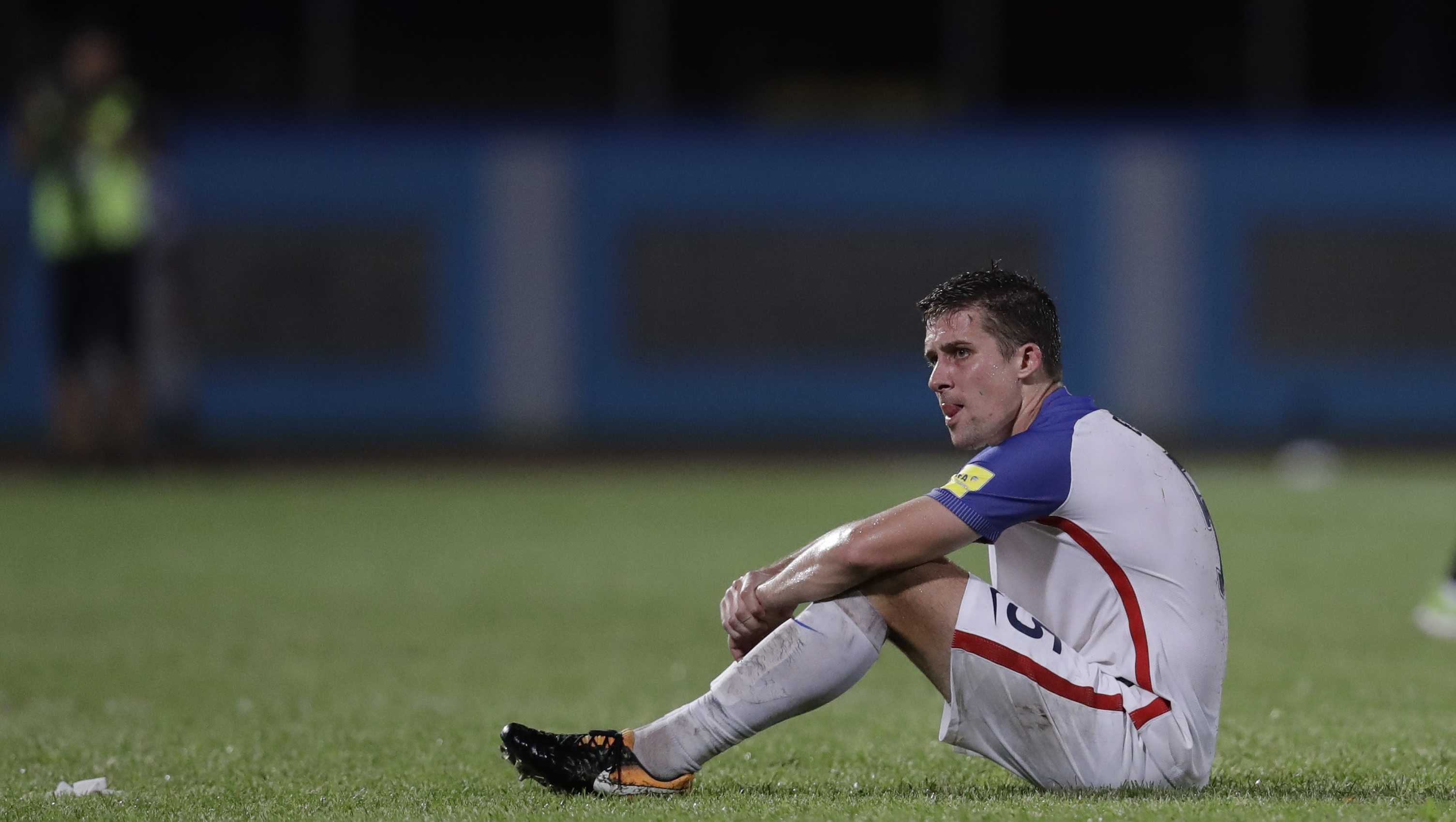 United States' Matt Besler, squats on the pitch after losing 2-1 against Trinidad and Tobago during a 2018 World Cup qualifying soccer match  in Couva, Trinidad, Tuesday, Oct. 10, 2017.