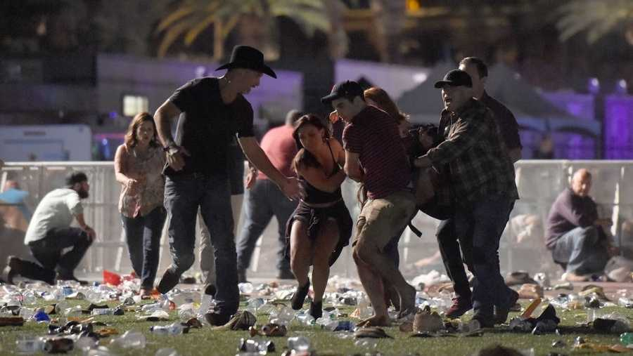 A Las Vegas shooting victim is carried by friends