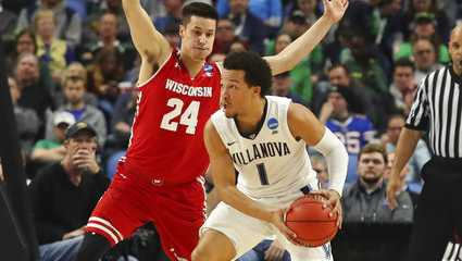 Villanova guard Jalen Brunson (1) is defended by Wisconsin guard Bronson Koenig (24) during the first half of a second-round men's college basketball game in the NCAA Tournament, Saturday, March 18, 2017, in Buffalo, N.Y.