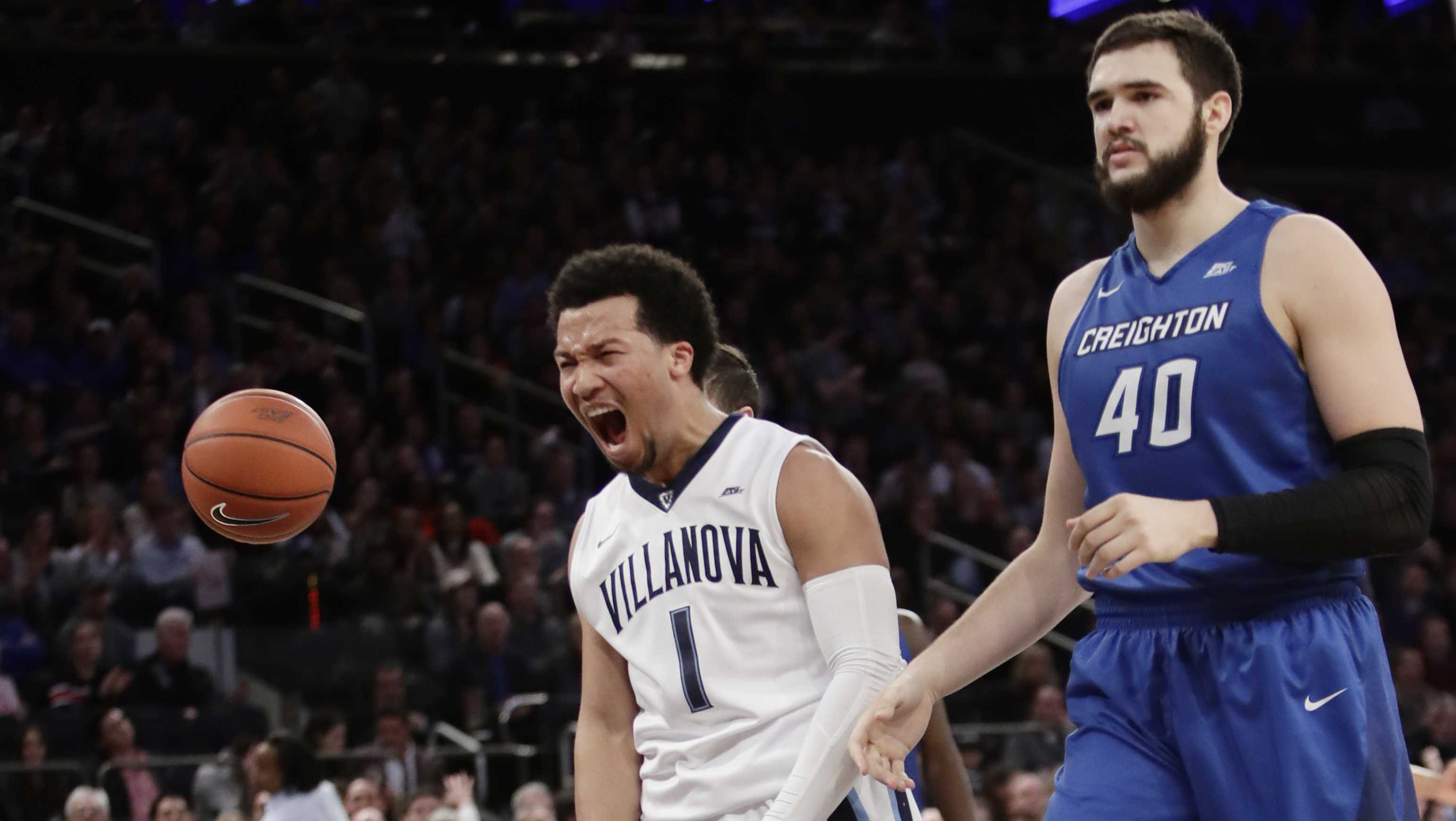 Villanova's Jalen Brunson (1) celebrates after scoring as Creighton's Zach Hanson (40) reacts during the first half of a championship NCAA college basketball game in the finals of the Big East men's tournament Saturday, March 11, 2017, in New York.