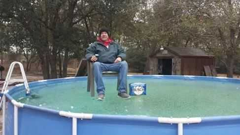 Tim McCoy on his pool with a case of beer in his original viral photo. (Source: Dana Kimrey)